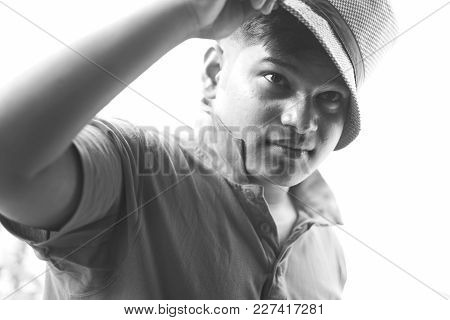 Portrait Of A Handsome Young Man In Hat.