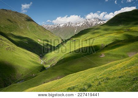 Landscape Of A Mountain Valley With View At Mountain River And Mountain Range.
