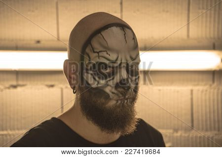 Make Up The Skull. A Bald Guy With A Beard With A Makeup Skull. A Man With A Makeup Skull. A Terribl