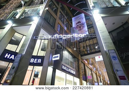 Munich, Germany - December 11, 2017 : A Low Angle View Of The Illuminated Ornated Kaufingertor Passa