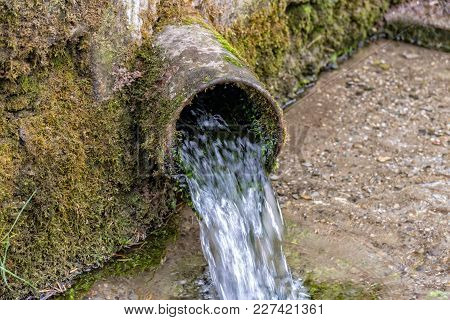 The Fresh Water Runs Out Of A Steel Pipe