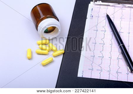 Stethoscope, Rx Prescription And Assorted Pills On White Table With Space For Text