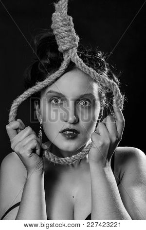 Sad Luxury Woman With Noose On Dark Background Looking At Camera