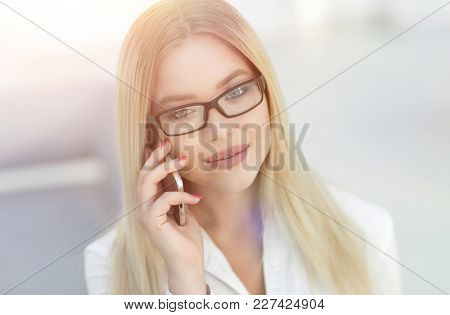 closeup of confident business woman talking on a mobile phone.