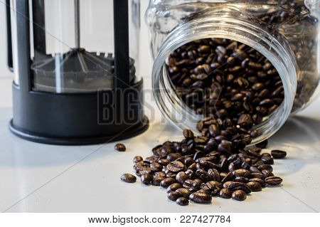 Morning Coffee In The Kitchen. Coffee Grinder And Coffee Maker With Coffee Makers On A White Kitchen