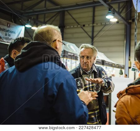 Strasbourg, France - Feb 19, 2018: Sommelier Selling Teaching Customers Tasting Buying French Wine A