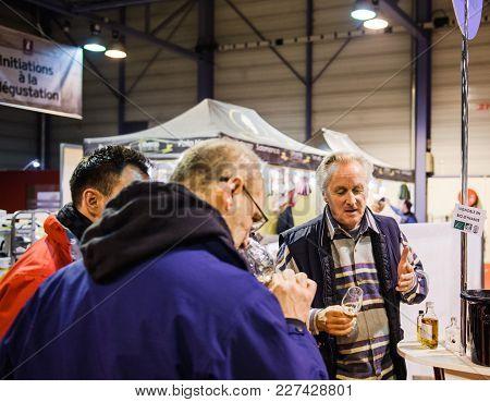 Strasbourg, France - Feb 19, 2018: Sommelier Selling Explaining To Customers Tasting Buying French W