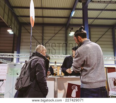 Strasbourg, France - Feb 19, 2018: Male Customers Tasting And Buying French Wine At The Vignerons In