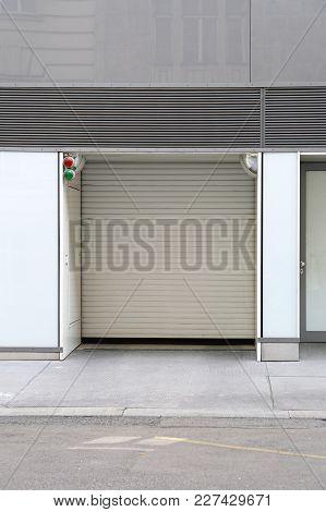 Garage Door At Building With Traffic Light