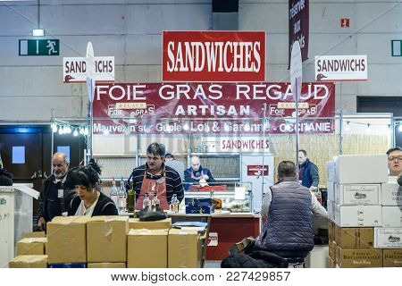 Strasbourg, France - Feb 19, 2018: Customers Tasting And Buying French Wine And Foie Gras At The Vig