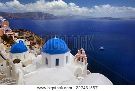 Blue dome church of beautiful Oia in Greek Island of Santorini, Greece