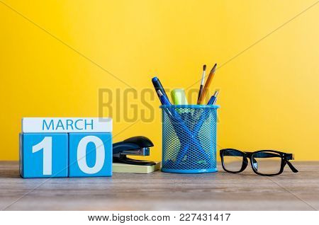 March 10th. Day 10 Of March Month, Calendar On Table With Yellow Background And Office Or School Sup