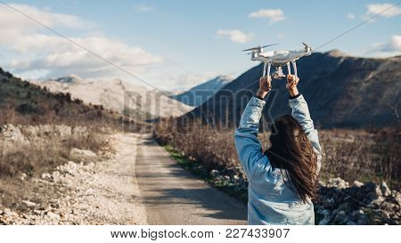 Young Woman Videographer Catching Flying Aircraft With Camera.controlling Landing Of Drone.female Fi