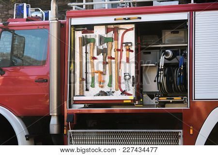 Fire Truck With Firefighting Equipment At The Fire Station