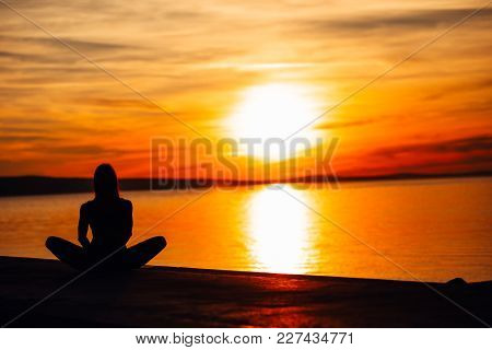 Carefree Woman Meditating In Nature.finding Inner Peace.yoga Practice.spiritual Healing Lifestyle.en