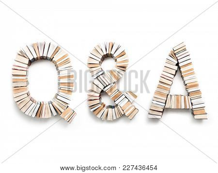 Q & A letters formed from books, shot from above on white background