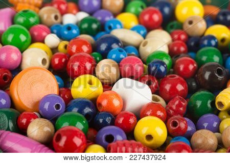 Colorful Mixed Wooden Beads In Detail. Shot In Studio.