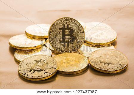 Golden Bitcoins On Bright Background. Shot In Studio.