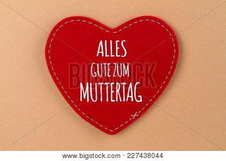 Red Heart Of Felt With Lettering In German Language - Happy Mothers Day