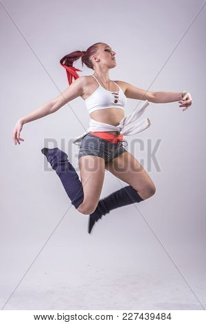 Young Modern Dancer, Teenage Girl Performing Dance Moves, Jumps And Break-dance Motions, Studio Imag