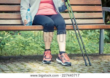 Vintage Photo, Elderly Senior Woman Sitting On Bench And Resting After Nordic Walking, Concept Of He