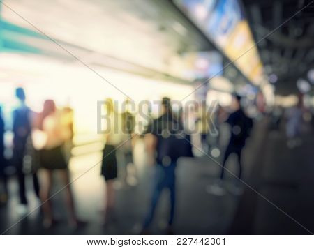 Abstract Blurred Image Of People Line Up Waiting For Electric Sky Train Station, Railroad Transporta