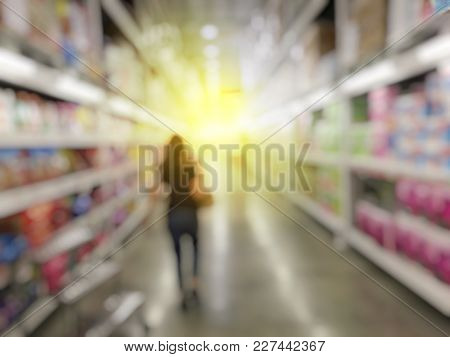 Abstract Blurred Image Of Business Woman Go To Shopping And Find Something To Buy At The Shelves In