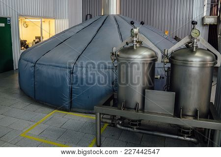Steel Fermentation Mash Vat At Brewery. Tanks With Ingredients