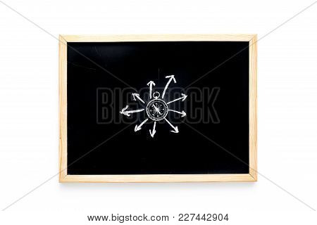 Direction Of Movement, Travel Direction. Compass Among The Arrows On Black Chalkboard On White Backg