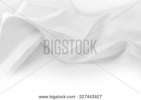 Rippled white silk fabric. Copy space