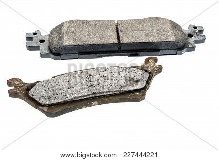 An Old And New Brake Pad On An Isolated Background