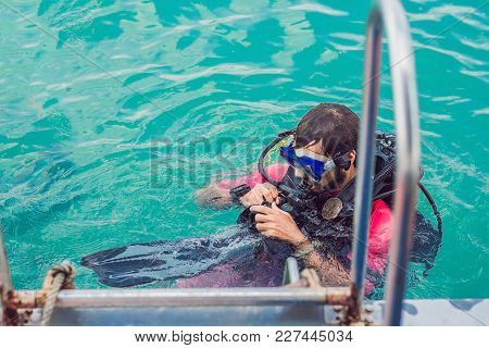 Happy Diver Returns To The Ship After Diving