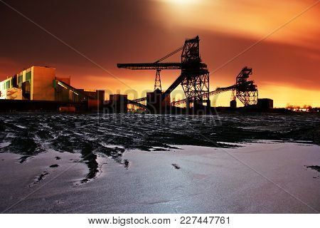 Fossil Fuel Power Station Coal Field Conveyor Belts Silhouette On Winter Sunrise