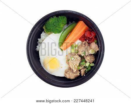 Fried Pork With Korean Sauce And Rice, Fried Egg With Steamed Vegetables In Black Plastic Tray Isola