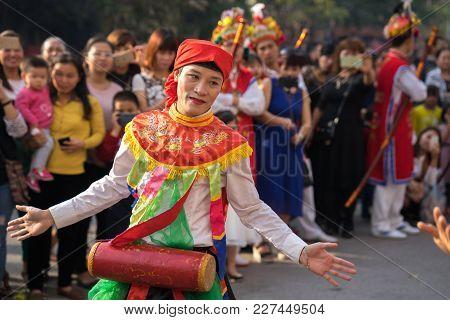 Hanoi, Vietnam - Feb 5, 2017: Men With Women Dress Performing Ancient Dance Called Con Di Danh Bong