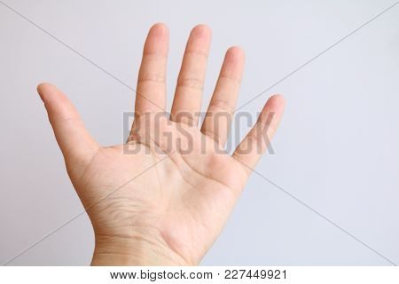The Palm Of The Hand Is Extended Forward