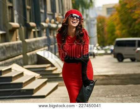 Cheerful Pretty Stylish Woman Walking In City And Laughing