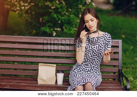 Young Model Enjoying A Break And Preparing To Make Her Lunch