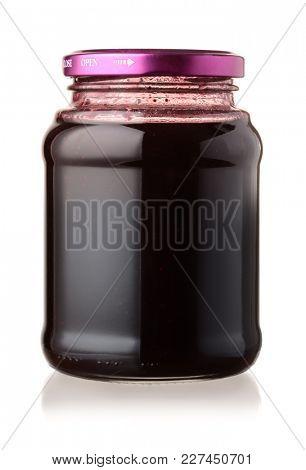 Jar of  blackberry jam isolated on white