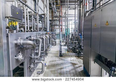 Modern Factory Interior. Stainless Steel Pipeline With Valve And, Manometers, Switch Boxes.