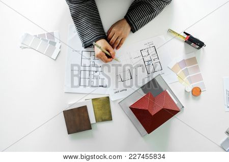 People sketching house plan blueprint