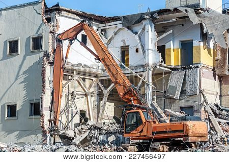 Demolition Of Old Building With Excavator For New Construction