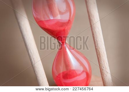 Time Concept. Hourglass. Running Out Of Time. Sandglass. Neutral Ivory Background