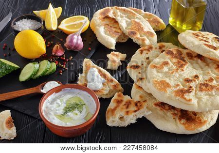 Freshly Baked Pita Bread With Yogurt Sauce