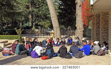 Jerusalem, Israel - December 3, 2017: Students Are Sitting On The Ground In Duration Of Open Lesson