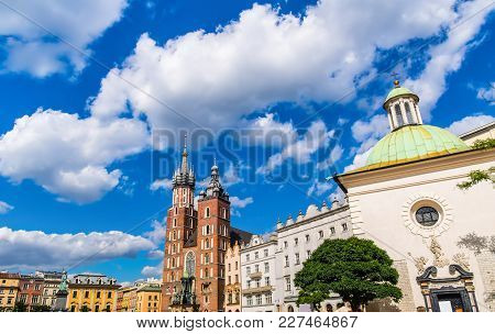 Saint Mary's Basilica And Church Of Saint Adalbert In Main Square Of Krakow On A Sunny Day. Cracow/k