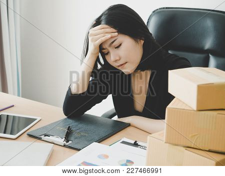 Female Office Worker Is Exhausted With Overworked