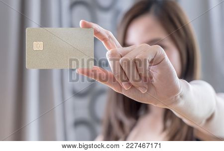 Beautiful Asian Woman Holding Golden Blank Credit Card