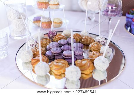 French Macaroons Cookies. Candy Bar. A Lot Of Sweets At The Wedding Banquet. Focus On The Lilac Maca