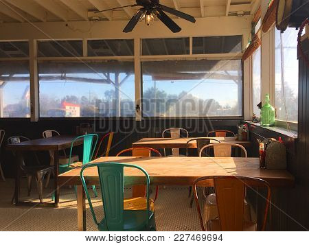 Sunshine Enters Window In Enclosed Dining Room